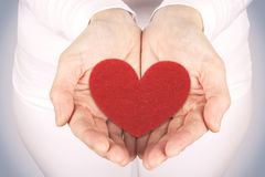 Taking the heart with hands Royalty Free Stock Photo