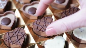 Taking Heart Shape Chocolate stock video footage