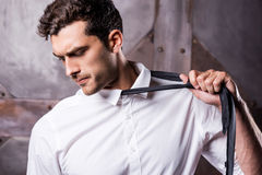 Taking his necktie away. Royalty Free Stock Images