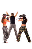 Taking a hostage. Two paintball girls takes a hostage Royalty Free Stock Image