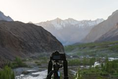 Taking landscape photography by dslr camera, at Hunza valley in Pakistan stock photography