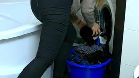 Taking laundry from washing mashine stock video footage