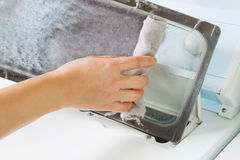 Taking the lent of Dryer Machine Royalty Free Stock Image
