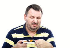 Taking a look at dried fruits skeptically Royalty Free Stock Photo