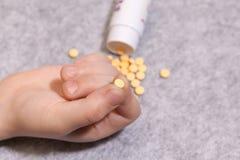 Taking medicine pills in hand, analgesic, treat. Taking medicine pills in hand, an analgesic, to treat disease Stock Image