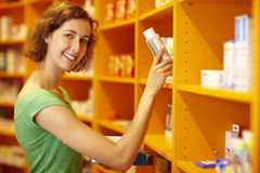 Taking medicine from shelf Stock Photo