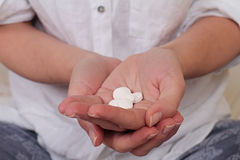 Taking medicine : woman holding pills close up. Healthcare and medical concept Stock Images