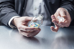 Taking medicine on the workplace Stock Photography