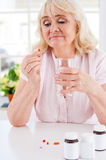 Taking medicines. Stock Images