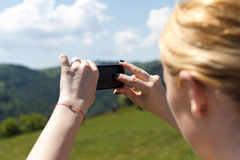 Taking memories. A moment captured in a photo travel from Apuseni mountains, near Marisel village Stock Image
