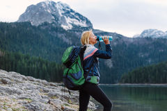 Taking a moment to catch her breath!. Young woman  stopping for a water break while  hiking Royalty Free Stock Image