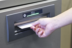 Taking money from ATM machine Royalty Free Stock Photo
