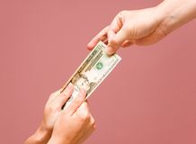 Taking money away. Male hand taking money away from female hands Stock Images