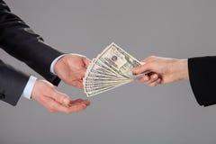 Taking money Royalty Free Stock Image