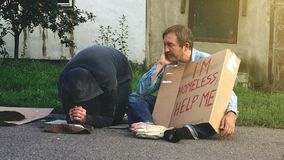 Taking money from homeless people stock video
