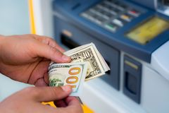 Withdraw money from ATM. Taking money out of the ATM Stock Photography