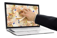 Taking money out of the screen. Conceptual shot of businessman's hand taking out euro banknotes out of a laptop display stock photography