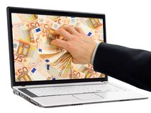 Taking money out of the screen. Conceptual shot of businessman's hand taking out euro banknotes out of a laptop display stock images