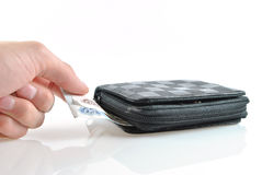 Taking money from wallet. Is isolated on a white background Stock Image