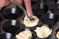Free Taking Muffin Dough To Baking Pan. Stock Image - 107825521