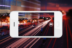 Taking night view photo with smartphone Stock Photography