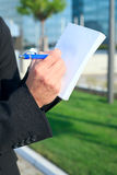 Taking a note Stock Photo