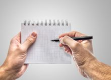 Taking notes. Hand holding notebook taking notes. PNG file available with transparent background Stock Photo