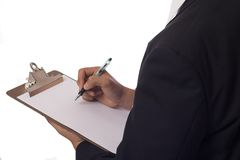 Taking notes. Man writing on a clipboard isolated Royalty Free Stock Image