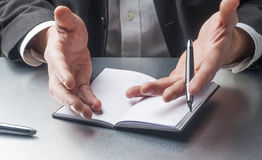 Taking notes in an agenda Stock Photo