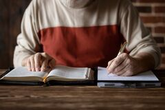 Taking Notes And Study Of The Holy Bible Royalty Free Stock Photography