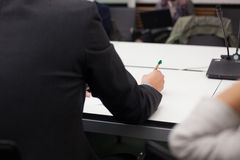 Taking notes at business meting Stock Photo