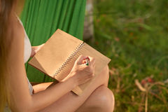 Taking Notes Outdoors Royalty Free Stock Photos