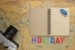 Travel planning concept top view. Taking notes to notebook on map background, copy space for text Royalty Free Stock Photo