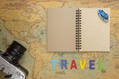 Travel planning concept top view. Taking notes to notebook on map background, copy space for text Stock Image