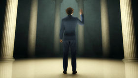 Taking an oath. Man pledging a statement of loyalty in hall of columns Stock Photos