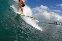 Taking off. A longboard surfer taking off on a wave royalty free stock images