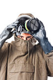 Taking off the gas mask. A man wearing an NBC Suite (Nuclear - Biological - Chemical stock image