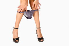 Taking off grey knickers Royalty Free Stock Photography