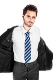 Taking off the jacket. A young and handsome businessman taking off his jacket over a white background Stock Photography