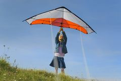 Taking off the kite. Children taking off a kite royalty free stock image