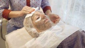 Taking off marine mug mask from female face. Full HD stock footage