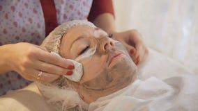 Taking off marine mug mask from female face. Full HD stock video