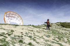 Taking off. Paraglider ready to take off Stock Photo
