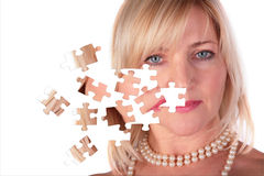Taking off puzzle from face of middleaged woman Stock Image