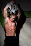 Taking off shirt Stock Photo