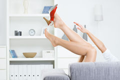 Taking off shoes stock photography