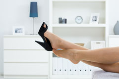 Taking off shoes Royalty Free Stock Photography