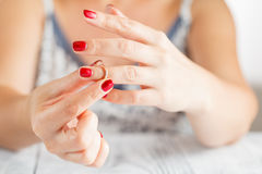 Taking off the wedding ring Royalty Free Stock Photo