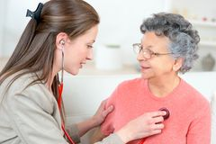 Taking old lady`s heartbeat royalty free stock photos