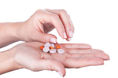 Taking one pill from pile Stock Photography
